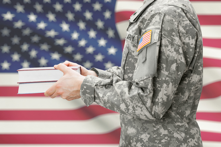 U.S. army soldier holding books in his hands