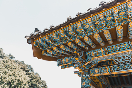 Neat roof-top of traditional buddhist monastery at mountainous area somewhere in South Korea