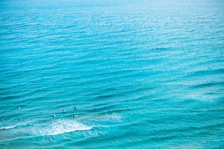 Jeju Island, South Korea: Enthusiastic people learning how to surf in the sea - Jeju Island, South Korea Stock Photo