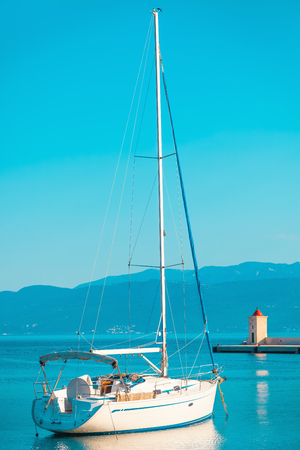 Fancy little yacht moored in the harbor of a small town Postira - Croatia, Brac island