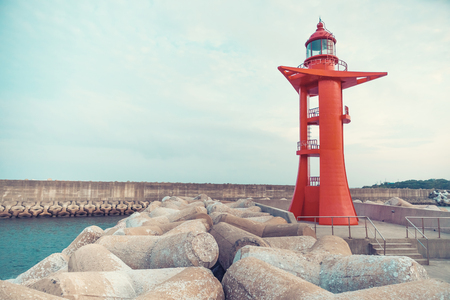 Seascape with modern red color lighthouse at Jeju Island - South Korea