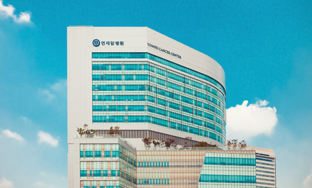 SEOUL, KOREA - AUGUST 12, 2015: Yonsei University Cancer Center - writing on the building means