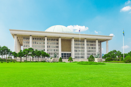 SEOUL, KOREA - AUGUST 14, 2015: Building of National Assembly Proceeding Hall - South Korean Capitol building - located on Yeouido island - Seoul, Republic of Korea