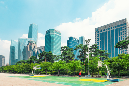 SEOUL, KOREA - AUGUST 14, 2015: Yeouido - Seoul's main finance and investment banking district and office area of Korea's top businesses in finance, IT and manufacturing industries - Seoul, South Korea Редакционное