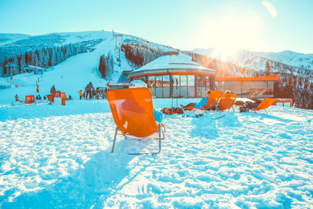 CHOPOK, SLOVAKIA - JANUARY 11, 2017: Skiers and snowboarders relaxing in apres ski bar chairs at Chopok downhill area - Slovakia