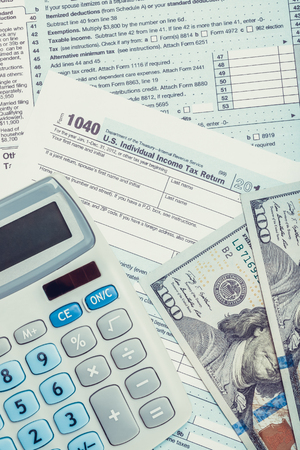 Tax Form 1040 With Calculator And Us Dollars Over It Close Stock