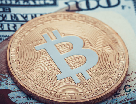 Hundred USA dollars banknote with one golden bitcoin over it Standard-Bild
