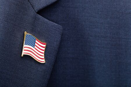 Element of male suit with USA flag pinned at chest area - studio shot