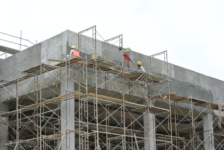 Plastering work by construction workers