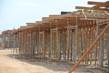 SELANGOR, MALAYSIA ? AUGUST 2014: Timber beam formwork supported by row of scaffolding in construction site in Malaysia
