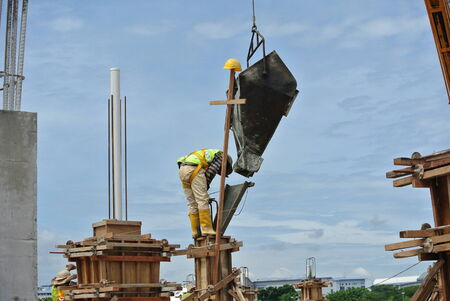 Construction workers casting column photo