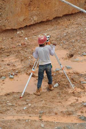 Surveyor with survey equipment photo
