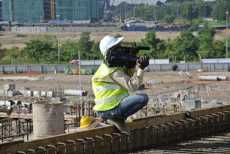 dangerous construction: A photographer was recording the construction activity at the construction site. Editorial