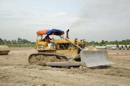 substantial: A bulldozer is a crawler equipped with a substantial metal plate used to push large quantities of soil, sand, rubble, or other such material during construction or conversion work. Editorial