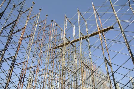 erection: Scaffolding erection to give temporary support for beams and slab formwork. Only licence installer allowed to install the scaffolding.  It is usually a modular system of metal pipes or tubes.