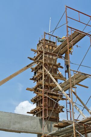 formwork: A construction workers fabricating column formwork