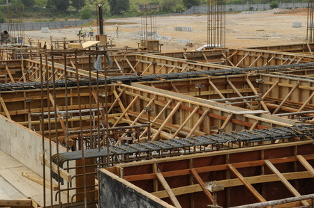 roof beam: Roof Beam formwork fabricated at construction site. The formwork verticality and horizontality supported by series of wooden support and scaffoldings. The formwork was completed and ready to receive concrete.