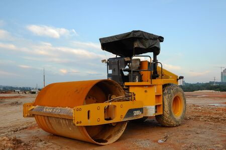 gravel roads: A road roller is a compactor type engineering vehicle used to compact soil, gravel, concrete, or asphalt in the construction of roads and foundations. Stock Photo