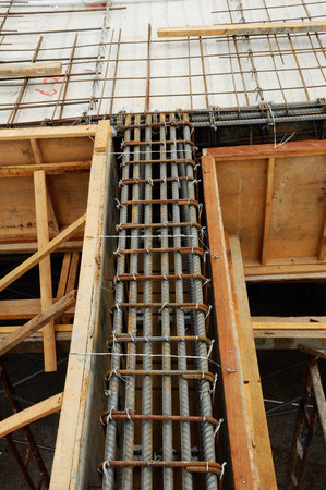 structural engineers: Steel reinforcement bars arranged and tied, before pouring the concrete and become part of the building structure. All these arrangements were designed by structural engineers design was used according to the set.