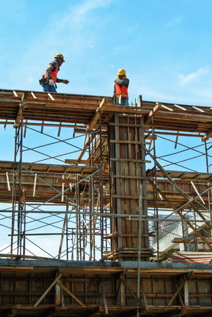 formwork: Construction workers fabricating beam formwork on July 25, 2014 at Sepang, Malaysia. Formwork is fabricated from wood and plywood.