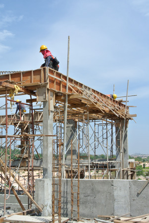 fabricating: Construction workers fabricating beam?s reinforcement bar on July 19, 2014 at Sepang, Malaysia.