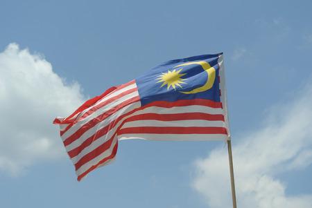 Maleisische Vlag in winderige lucht op 17 augustus 2014 Seremban, Negeri Sembilan, Maleisië.