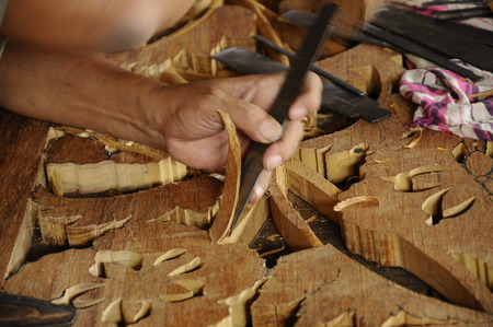 graver: Skilled craftsman doing wood carving using traditional method