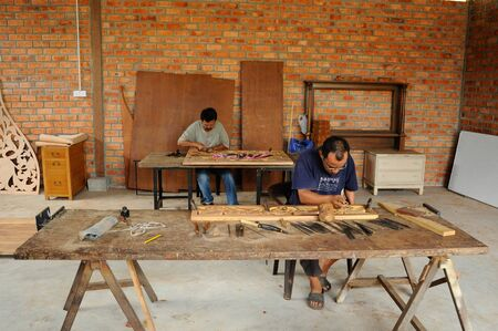 graver: Malaysian traditional woof carving using traditional method by skilled craftsman on November 6, 2014. Craftsman using floral motifs as inspiration to express their creativity.