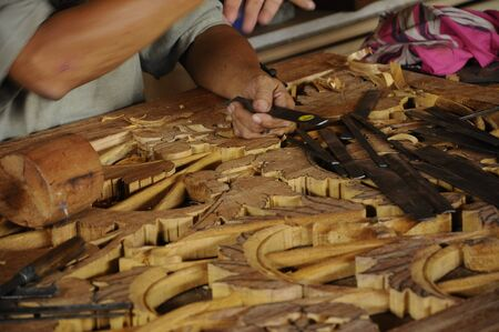 merbau: Malaysian traditional woof carving using traditional method by skilled craftsman on November 6, 2014. Craftsman using floral motifs as inspiration to express their creativity.
