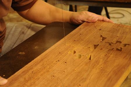 merbau: Malaysian traditional wood carving in progress