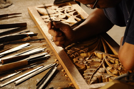 merbau: Malaysian traditional woof carving using traditional method by skilled craftsman on November 6, 2014. Craftsman using floral motifs as inspiration to express their creativity