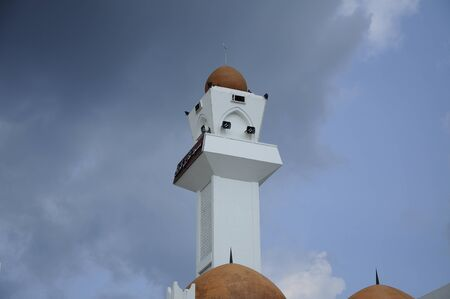 recite: Minaret of Perak State Mosque located in Ipoh Perak on 13.12.2014. It is landmark of Ipoh Town. This mosque uniqueness lies in its design as there are 125 domes on its roof. Editorial