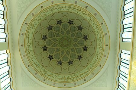 recite: Inside main dome of Perak State Mosque in Ipoh Perak on December 13, 2014. It is landmark of Ipoh Town. This mosque?s uniqueness lies in its design as there are 125 domes on its roof.