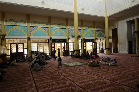 recite: Interior of The Masjid Jubli Perak Sultan Ismail Petra in Rantau Panjang, Kelantan, Malaysia. The mosque is also known as Masjid Beijing or Beijing Mosque due to its Chinese temple-like structure. Built between 2005 and 2009.