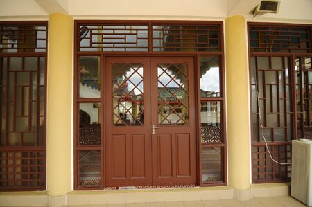 recite: Main door of The Masjid Jubli Perak Sultan Ismail Petra in Rantau Panjang, Kelantan, Malaysia. The mosque is also known as Masjid Beijing or Beijing Mosque due to its Chinese temple-like structure. Built between 2005 and 2009.