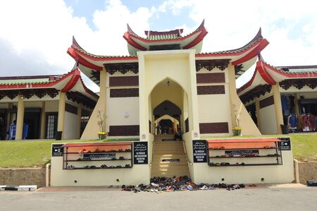 doa: Main entrance of The Masjid Jubli Perak Sultan Ismail Petra in Rantau Panjang, Kelantan, Malaysia. The mosque is also known as Masjid Beijing or Beijing Mosque due to its Chinese temple-like structure. Built between 2005 and 2009.