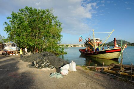 terengganu: Fishermen and crew are gearing parts and nets to catch fish in the boat before the sea. The photo was taken at Kuala Terengganu, Terengganu, Malaysia.