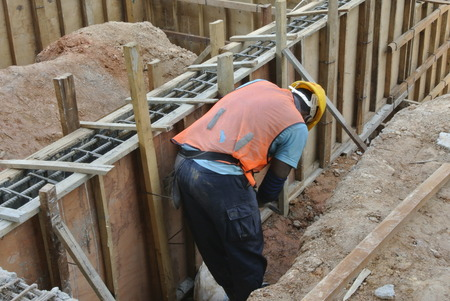 A Construction Workers Installing Ground Beam Formwork