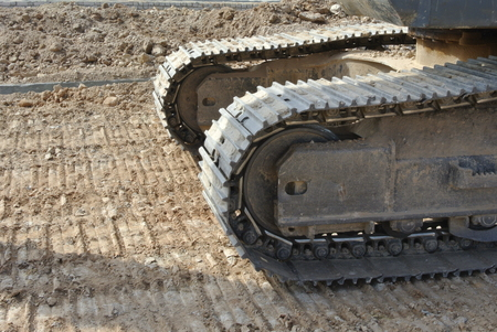 facilitate: Excavator track made of durable steel facilitate excavator through a variety of terrains without any problems. Stock Photo