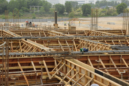 roof beam: Roof Beam formwork fabricated at construction site. The formwork verticality and horizontality supported by series of wooden support and scaffoldings. The formwork was completed and ready to receive concrete