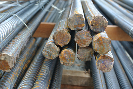 steel construction: Hot rolled deformed steel bars a.k.a. steel reinforcement bar used at construction site as the reinforcement bar for reinforcement concrete.