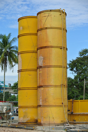 heavy risk: Silo made from metal used to keep water and bentonite for bored pile work. Stock Photo