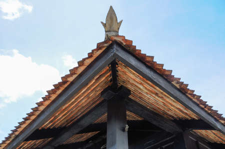 doa: Roof detail of Masjid Kampung Laut at Nilam Puri Kelantan, Malaysia. Built in 1400s with traditional tropical architecture style using wood as the major material.