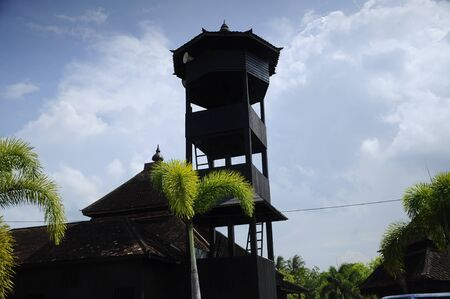 puri: Minaret of Masjid Kampung Laut at Nilam Puri Kelantan, Malaysia. Built in 1400s with traditional tropical architecture style using wood as the major material. Stock Photo