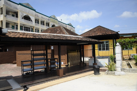 puri: Ablution of Masjid Kampung Laut at Nilam Puri Kelantan, Malaysia. Built in 1400s with traditional tropical architecture style using wood as the major material.