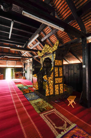 puri: Mimbar of Masjid Kampung Laut at Nilam Puri Kelantan, Malaysia. Built in 1400s with traditional tropical architecture style using wood as the major material.