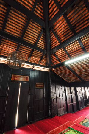 puri: Interior of Masjid Kampung Laut at Nilam Puri Kelantan, Malaysia. Built in 1400s with traditional tropical architecture style using wood as the major material.