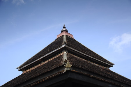 puri: Roof of Masjid Kampung Laut at Nilam Puri Kelantan, Malaysia. Built in 1400s with traditional tropical architecture style using wood as the major material.