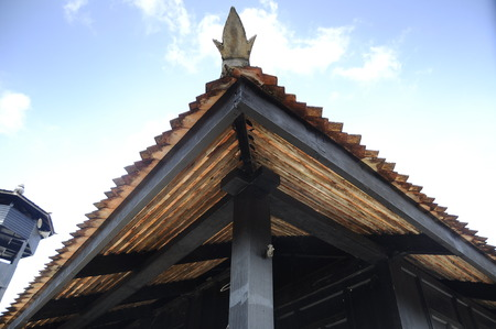 puri: Roof detail of Masjid Kampung Laut at Nilam Puri Kelantan, Malaysia. Built in 1400s with traditional tropical architecture style using wood as the major material.