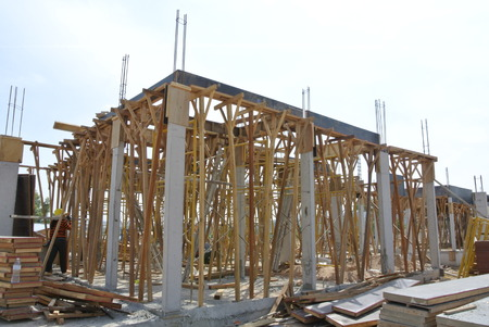 roof beam: Roof beam formwork fabricated at construction site and supported by series of wooden support .